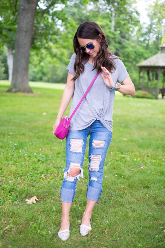 gray tee and ripped jeans