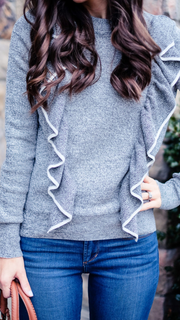 gray ruffled sweater