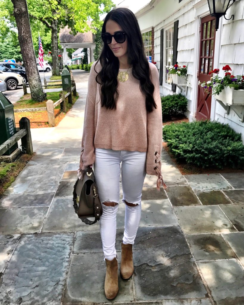 blush pink sweater and white jeans